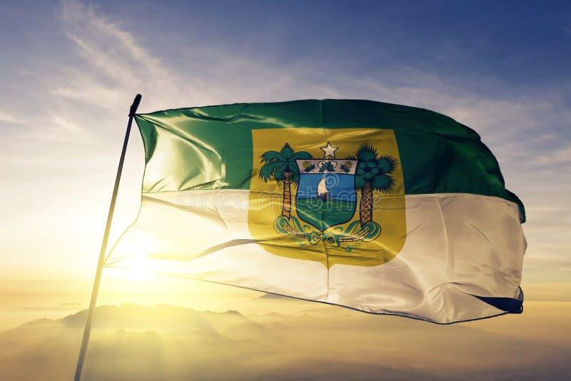 巴西旗子纺织品挥动在顶面日出薄雾雾的布料织品北里约格朗德状态  皇族释放例证
