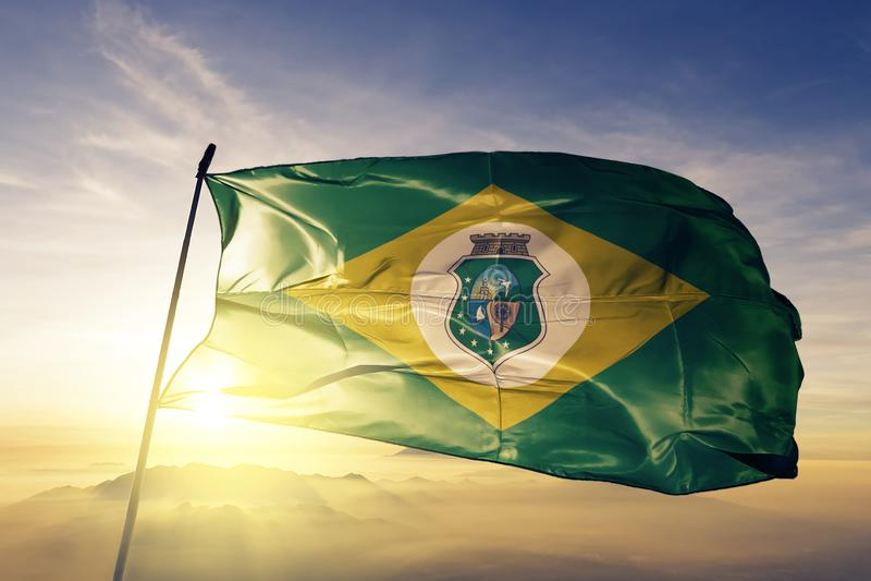巴西旗子纺织品挥动在顶面日出薄雾雾的布料织品塞阿拉州状态  库存例证