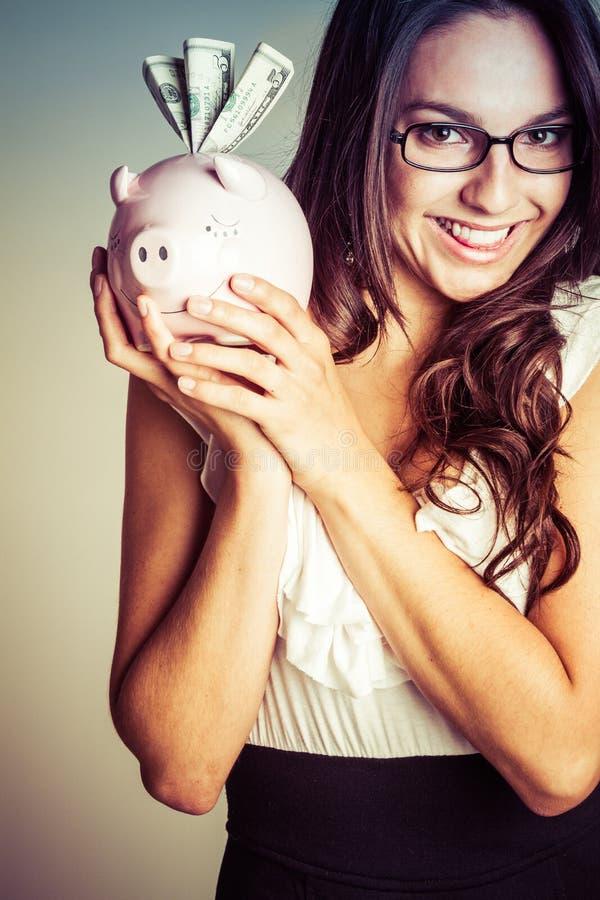 货币微笑的妇女 免版税库存照片