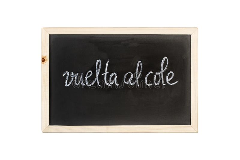 布埃尔塔回到学校词的Al油菜在白垩写在黑板 库存图片