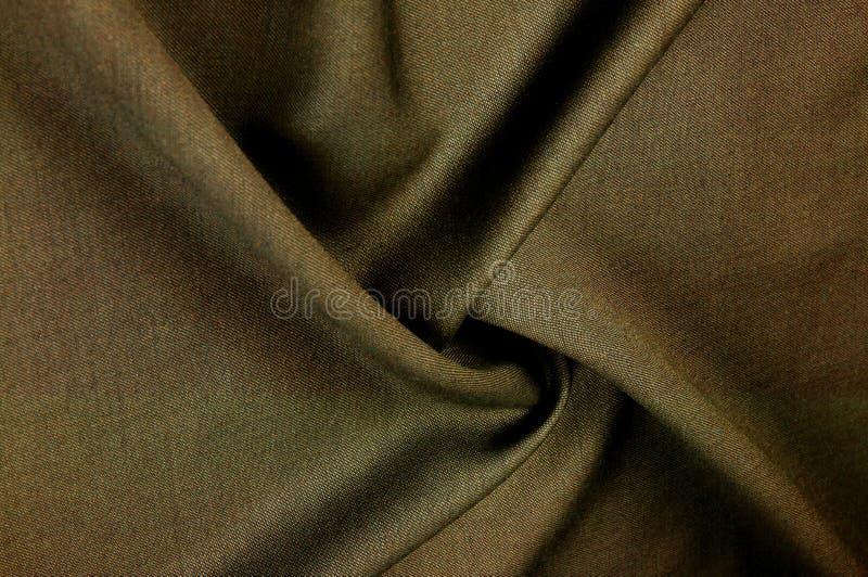 布料羊毛衣服茶 非常逗人喜爱的两面的灰色棕色古色古香的fabr 图库摄影