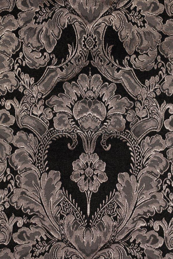 布朗与锦缎样式的葡萄酒织品作为背景 库存图片