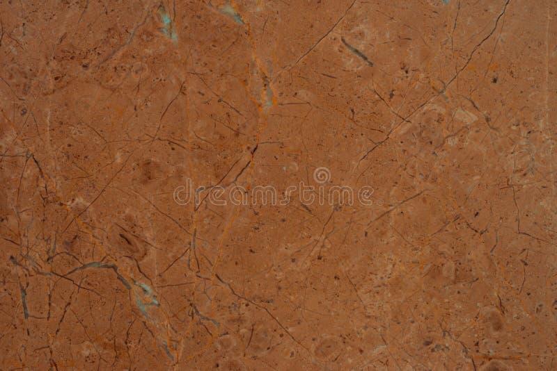 布朗使石无缝的背景样式或纹理有大理石花纹 免版税库存照片
