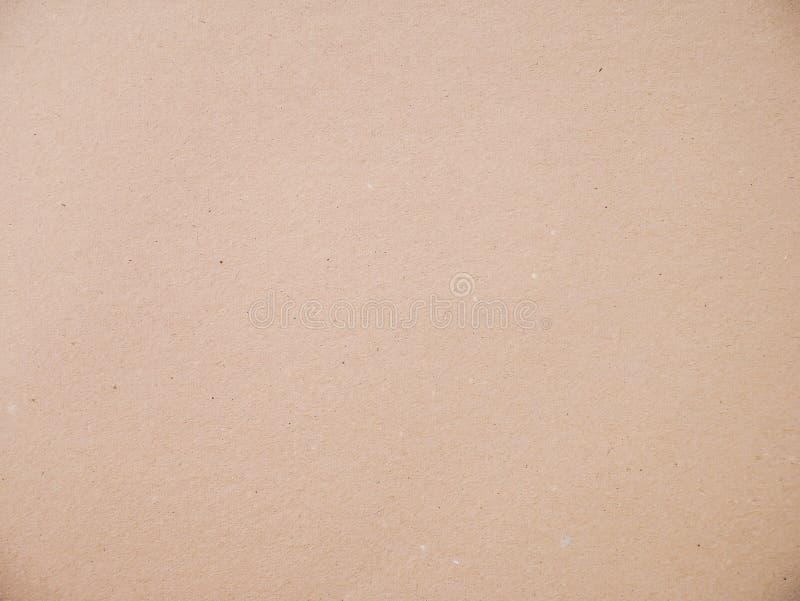 布朗回收了老纸纹理或棕色工艺纸盒老概略的简单的轻的纸板背景 库存图片