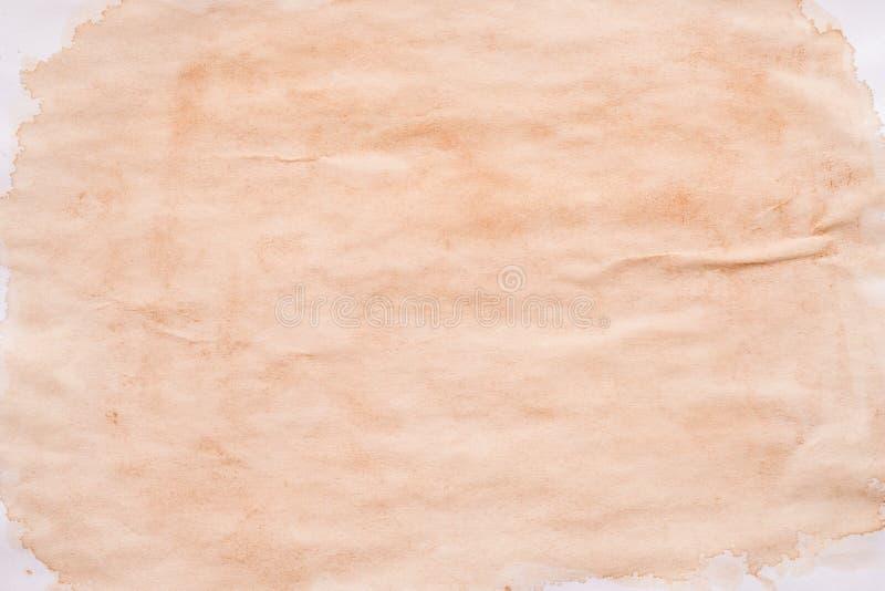 布朗污点弄脏了纸背景溢出的茶 免版税库存图片