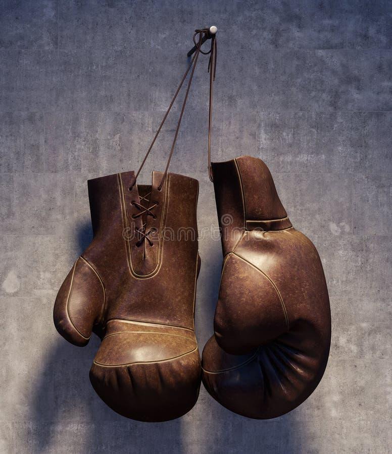 布朗用皮革包盖垂悬在脏的混凝土墙上的拳击手套 库存图片
