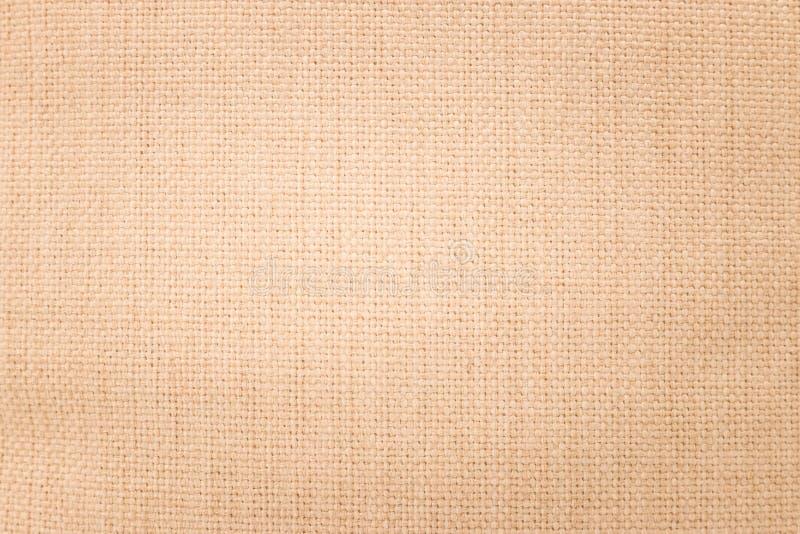 布朗粗麻布纹理背景 编织纺织材料或空白的布料 库存图片
