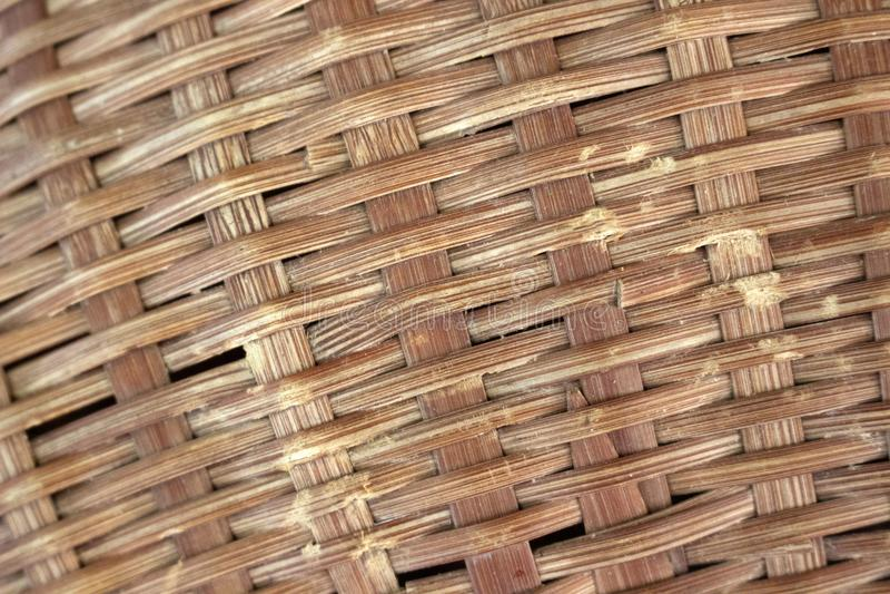 布朗纹理的被编织的竹子关闭 库存照片