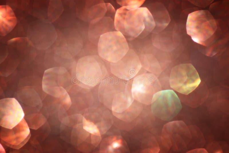 布朗背景。与bokeh defocused光的典雅的抽象背景 免版税图库摄影