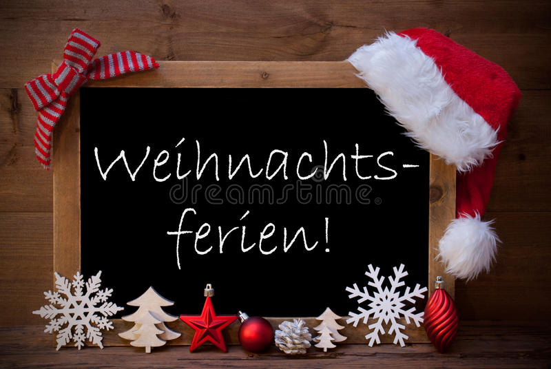 布朗黑板帽子Weihnachtsferien意味圣诞节假日 库存照片