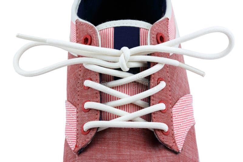帆布鞋的鞋带结 免版税库存图片