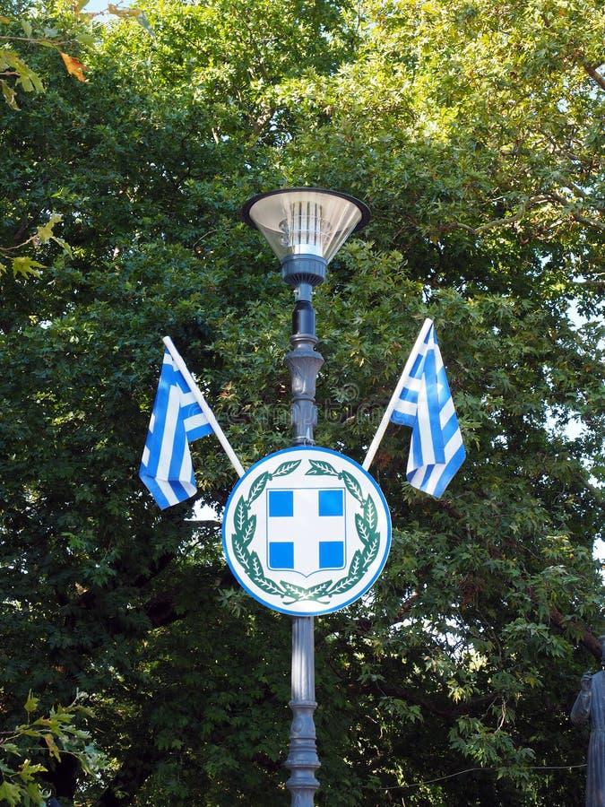 希腊国旗和徽章,希腊 免版税库存照片