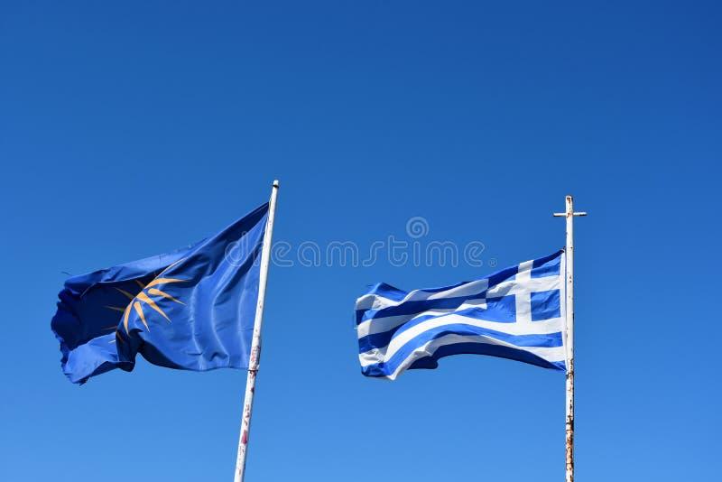 希腊旗子和希腊地区马其顿的非官方的旗子 免版税图库摄影