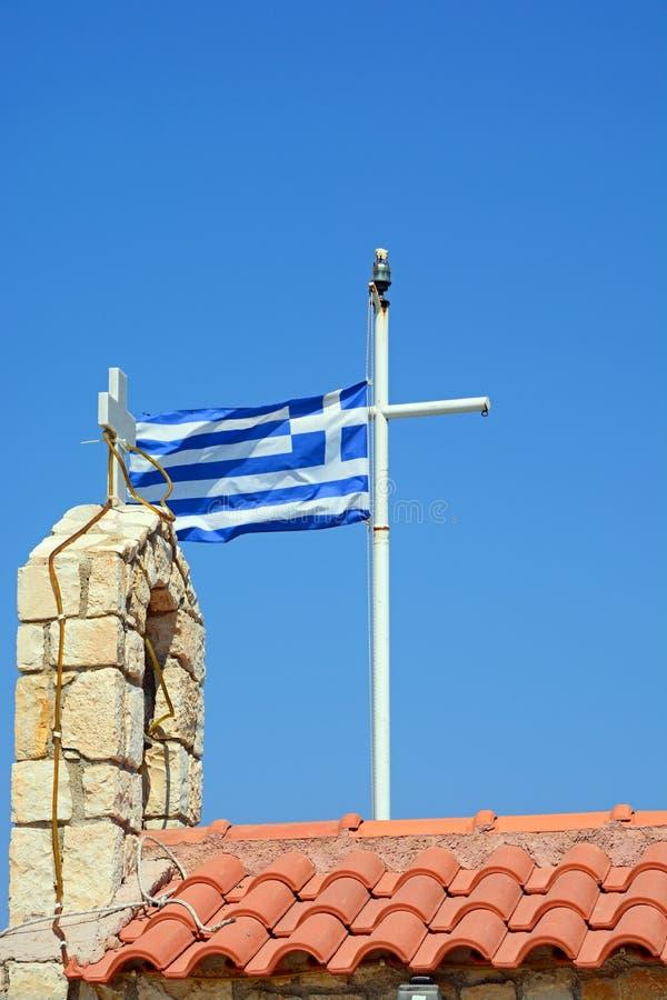 希腊旗子和钟楼, Kalyves 库存照片