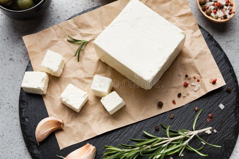 希腊白软干酪和香料块在船上 免版税图库摄影