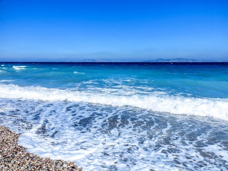 希腊颜色-在罗得岛Pebble海滩的美好的颜色  库存图片