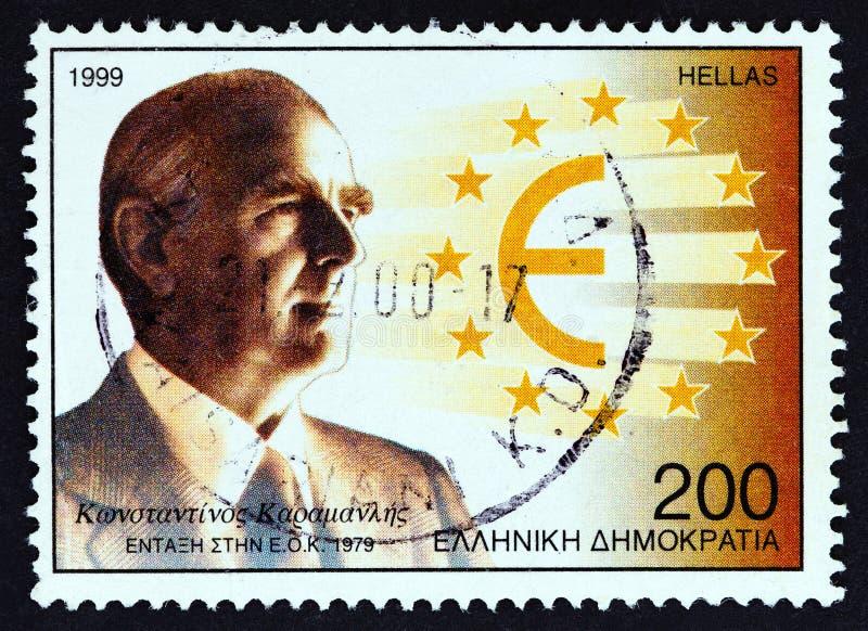 希腊 — 1999年:在希腊印有的邮票显示了1999年左右希腊加入欧共体的康斯坦丁诺斯卡拉曼利斯 库存照片