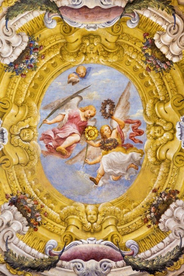 帕尔马,意大利- 2018年4月17日:天使壁画与殉教的标志的在教会基耶萨di圣诞老人露西娅wault的  库存照片
