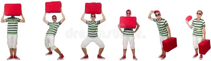 带着在白色隔绝的红色手提箱的年轻人 图库摄影