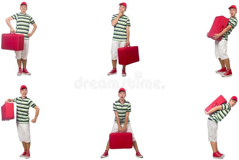 带着在白色隔绝的红色手提箱的年轻人 免版税图库摄影