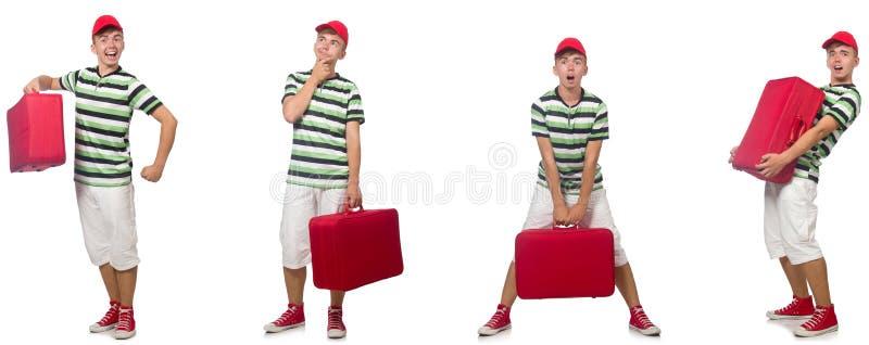 带着在白色隔绝的红色手提箱的年轻人 库存照片
