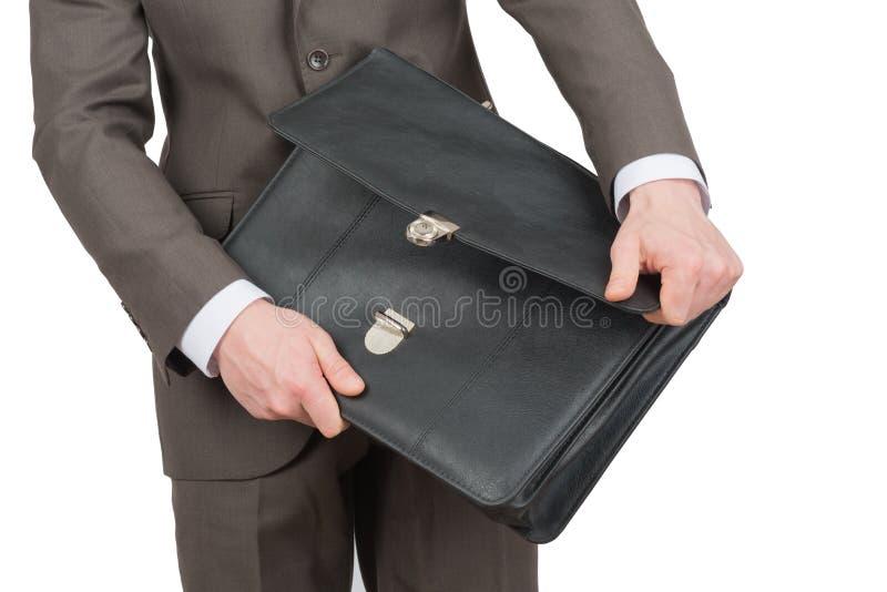 带着开放手提箱,正面图的商人 库存图片