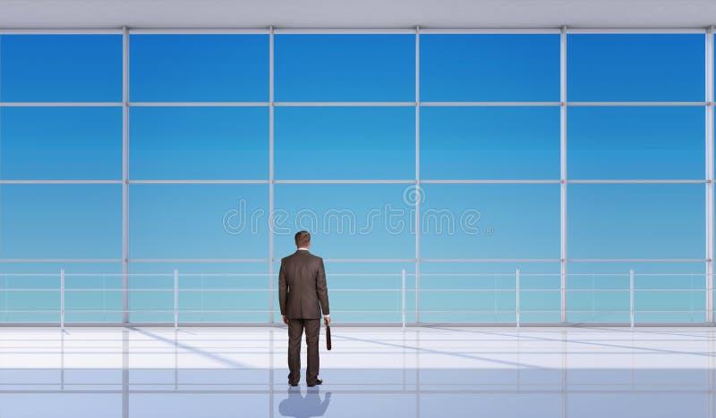 带着手提箱的商人在窗口前面 免版税库存图片