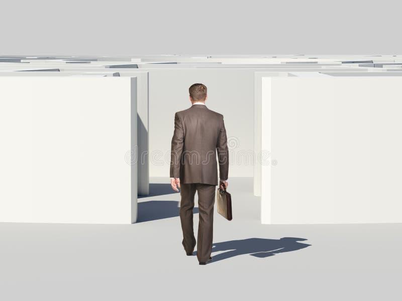 带着手提箱的商人进入迷宫 库存图片