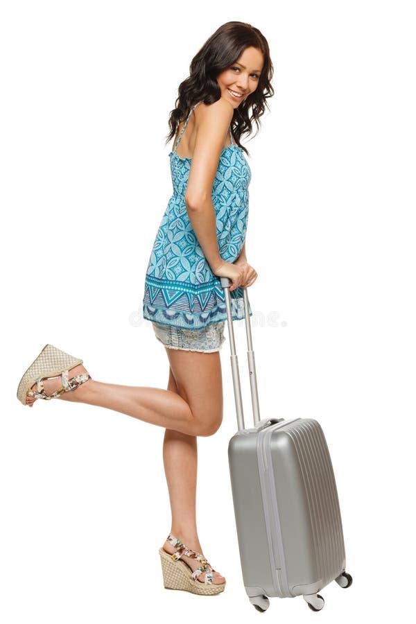 带着手提箱的愉快的微笑的妇女 库存照片