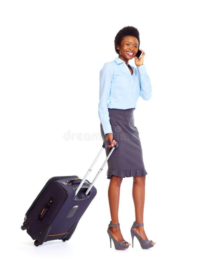 带着手提箱的非洲女商人 库存照片