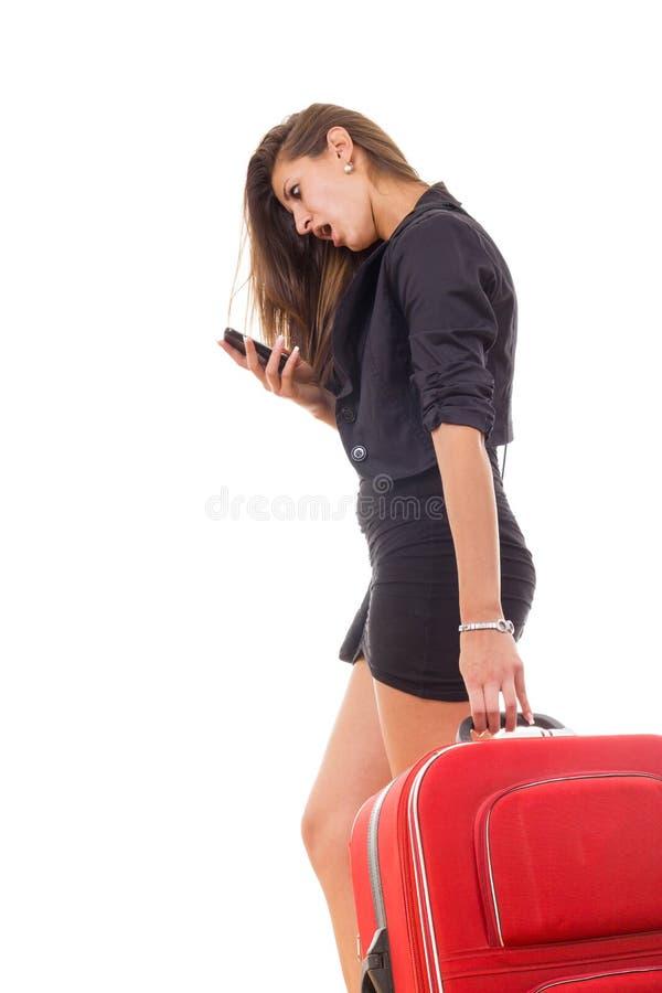 带着旅行手提箱的震惊女商人 免版税库存照片