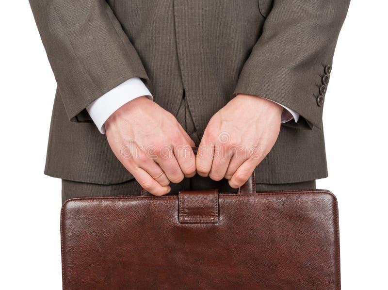 带着棕色手提箱,正面图的商人 免版税库存照片