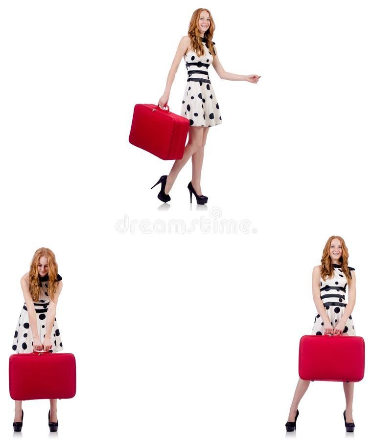 带着红色手提箱的年轻美女 免版税库存照片