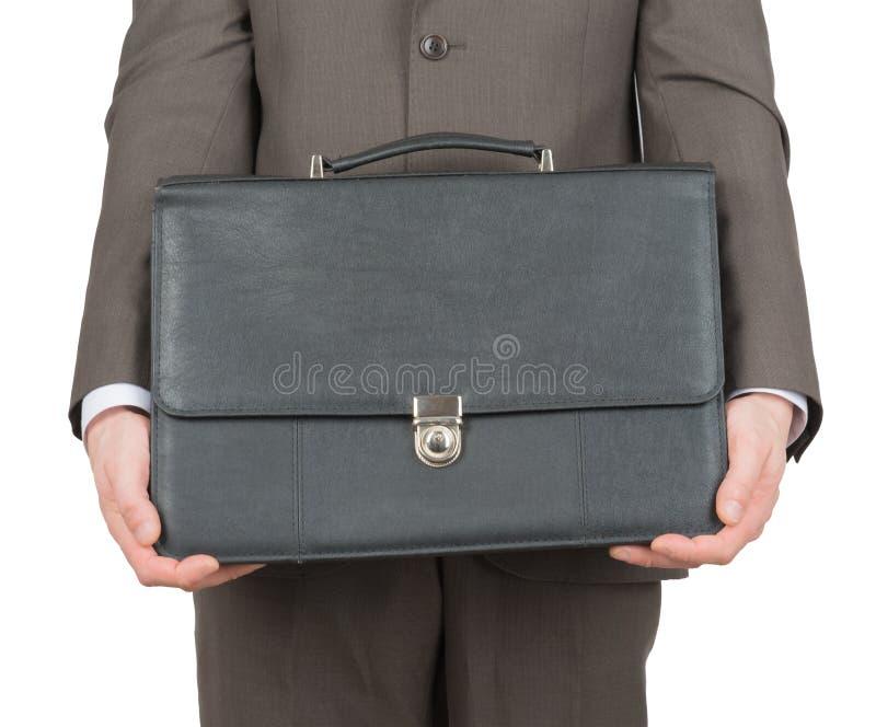 带着黑手提箱,正面图的商人 免版税图库摄影
