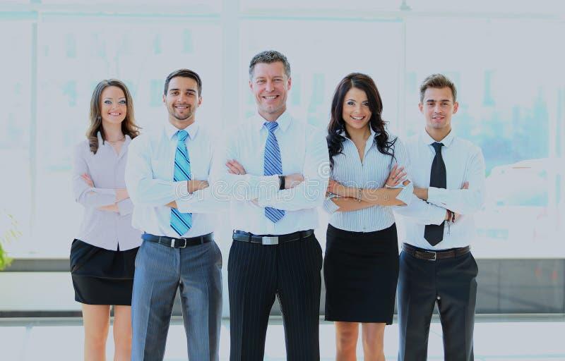 带领他的队的商人画象在办公室 库存照片