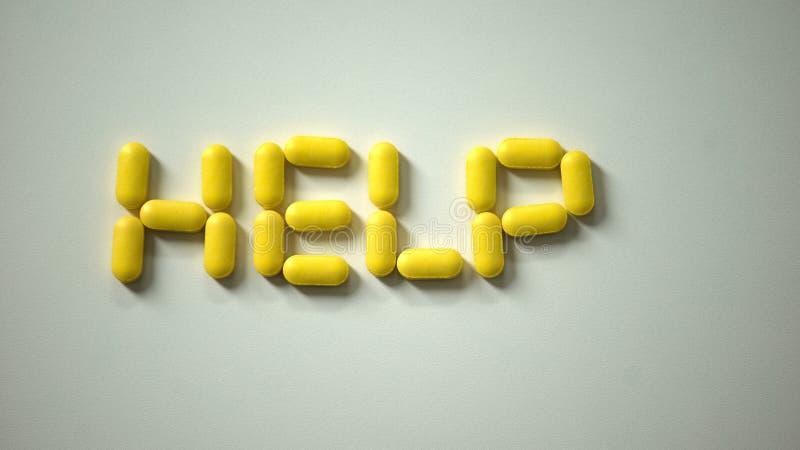 帮助词由药片做成在桌,国际病症了悟,竞选 库存图片