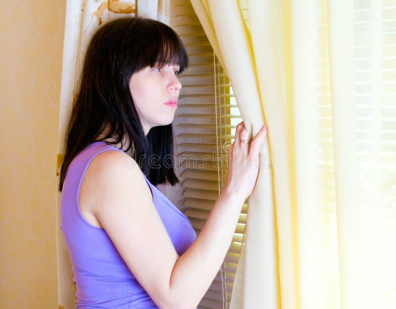 常设视窗妇女 库存图片