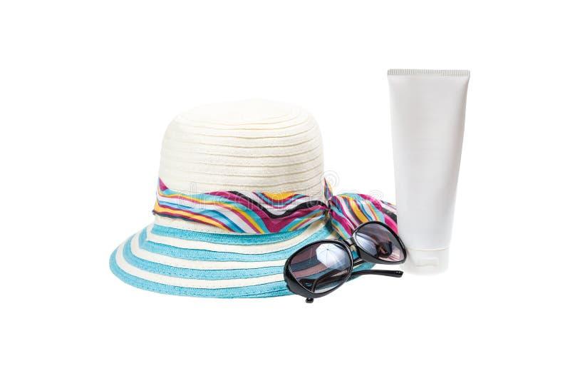 帽子、太阳镜和身体化妆水 免版税库存图片