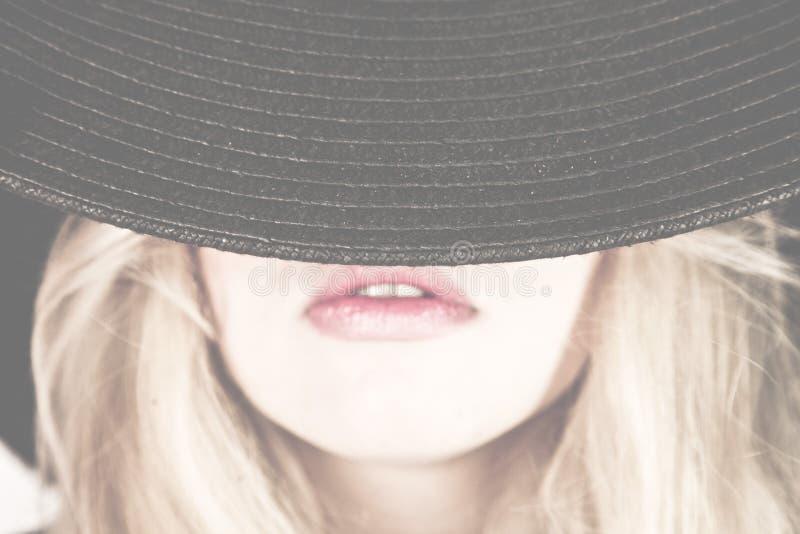 帽子妇女面孔 库存照片