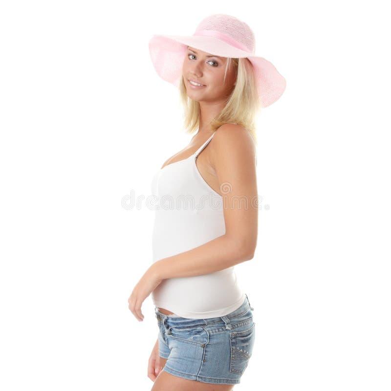 帽子桃红色秸杆佩带的妇女年轻人 库存照片