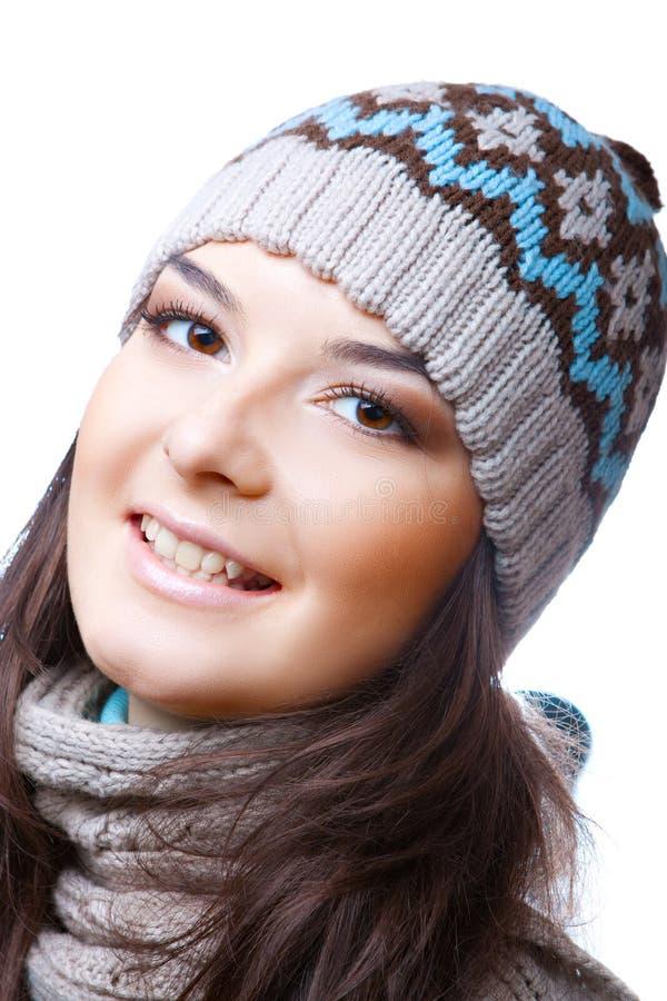 帽子的微笑的妇女 免版税库存图片