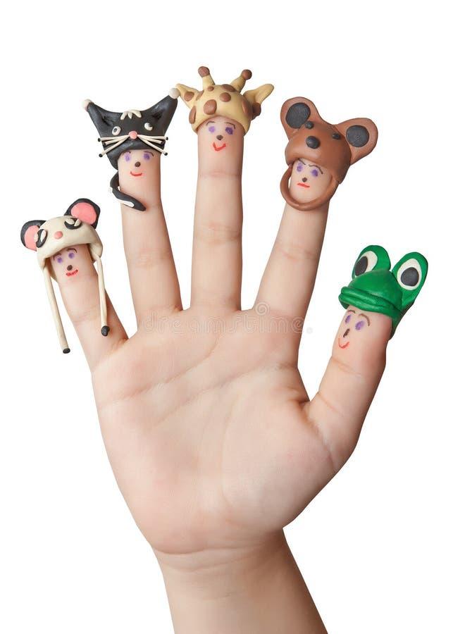 帽子的手指人从彩色塑泥动物 免版税库存图片