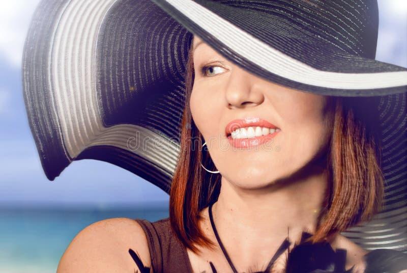 帽子的美丽的妇女 图库摄影