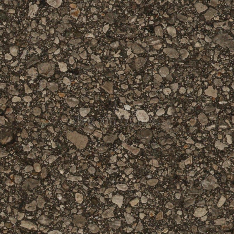 干燥,老地球无缝的纹理与优良品质小石头的  免版税图库摄影