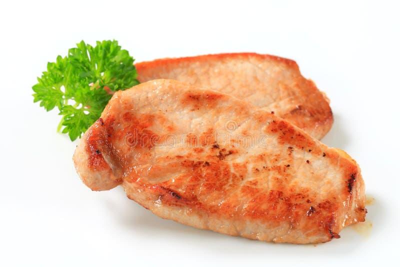 平底锅枯萎的猪肉炸肉排 库存照片