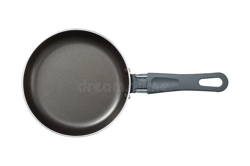 平底锅 黑色 辅助部件背景查出的厨房白色 为烹调的工具 一把匙子 背景查出的白色 设计您 一个对象 库存图片