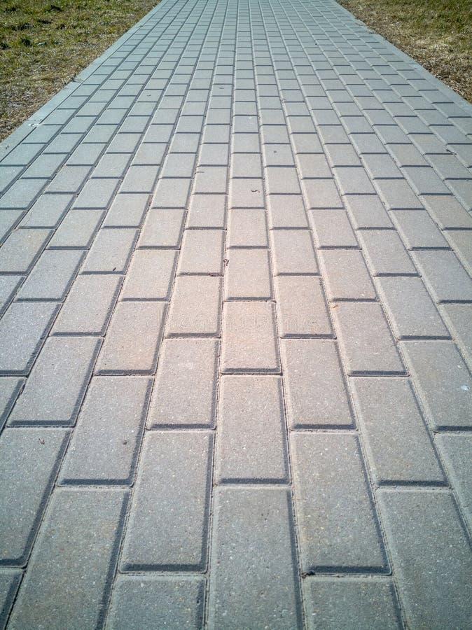 平直的灰色砖路面 库存图片