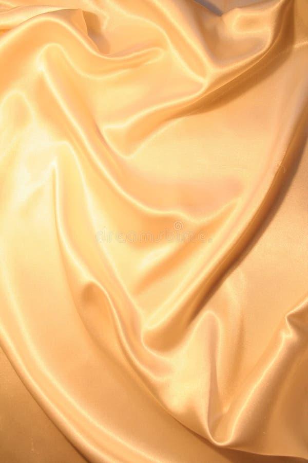 平稳背景典雅的金的缎 图库摄影