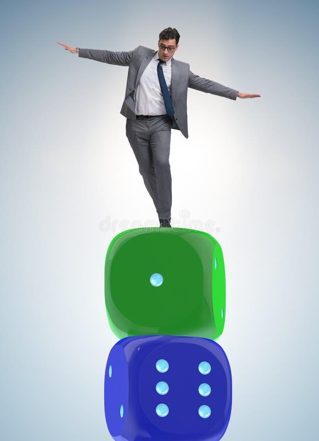 平衡在不确定性concep的模子堆顶部的商人 库存照片