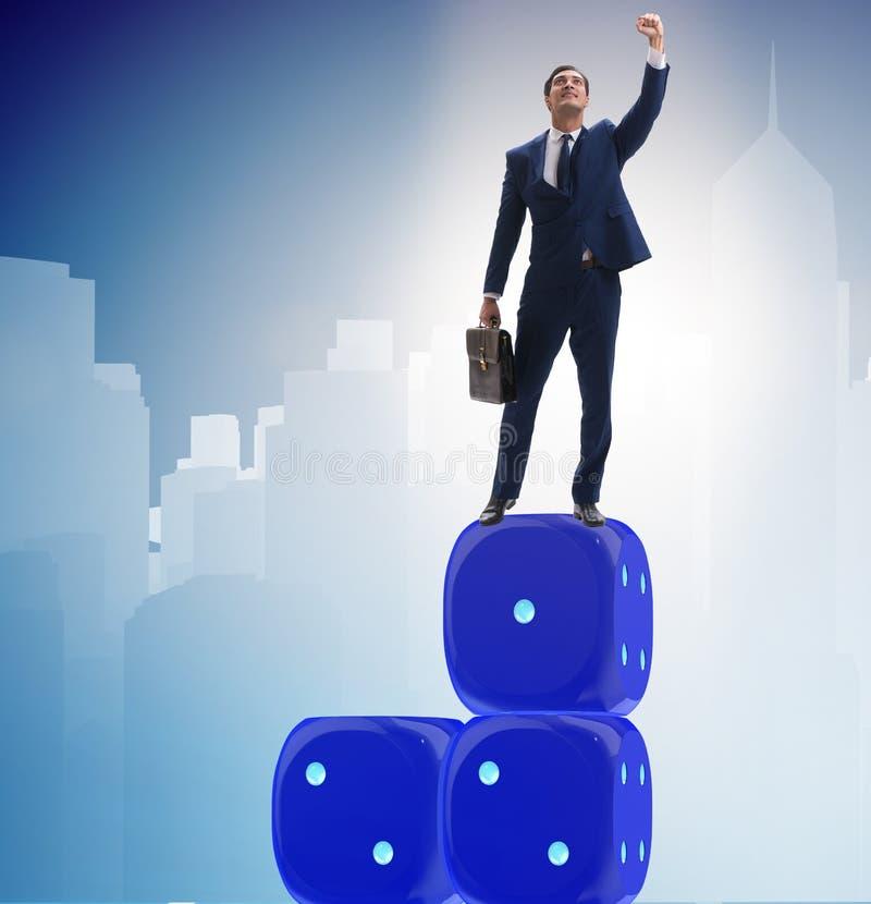 平衡在不确定性concep的模子堆顶部的商人 库存图片
